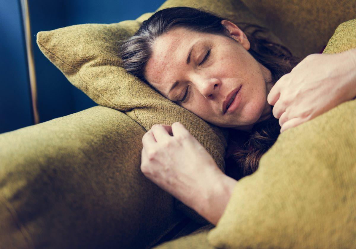 woman-sick-on-the-sofa-VKMP8GZ-1200x839.jpg