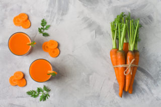 bigstock Bunch Of Carrot With Green Tw 244688536